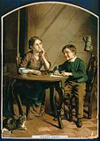 A young mother sits at the table with a small boy who is writing on a sheet of paper