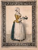 A woman carrying a cup of chocolate and a glass on a tray