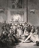 Groups of men and women entertain one another in a large room, one man is sitting astride a barrel