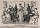 A man and woman stand talking together in the middle of the room as other couples amuse one another by playing the …