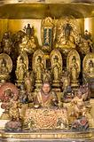 A domestic shrine with figures of 66 Shinto and Buddhist deities