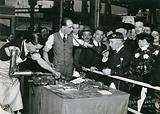 Sir Harry Lauder, the Scottish entertainer, at a prosthesis stand at a Daily Mail exhibition, Olympia, 1921: one man …