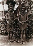 Two young Kikuyu tribesmen, carrying sticks
