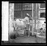 Peking, Pechili province, China: a travelling fruit-seller